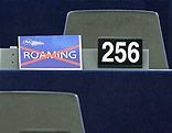 """Schild mit dem durchgestrichene Wort """"Roaming"""" im EU-Parlament"""
